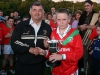 Joe Pyke (Chairman, Bord na nOg) presents Sean Meaney (Captain, St. Martins) with the U-14 \'B\' Hurling Cup.