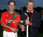 Ned Moran (Chairman, Northern Board) presents Ger Doyle (Captain, St. Martins) with the Northern Junior \'A\' Cup after they defeated Clara in the Final.