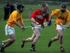 Getting out - St. Martins Alan Murphy takes the sliotar out of danger as Carrickshock\'s Paddy Mulcahy and James Moran close in.