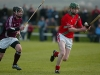Ready to clear - Mick Morrissey (St. Martins) about to strike the sliotar as Jody Creane (Clara) closes in during the Northern under-21 Hurling Final in Freshford.(Photograph: Eoin Hennessy)