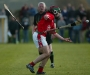 Juggling - John Mulhall (St. Martins) tries to juggle two hurls and a sliotar during the Northern under-21 Hurling Final in Freshford.(Photograph: Eoin Hennessy)