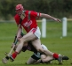 Striding through - Brian Mulhall (St. Martins) strides towards goal as Shane prendergast (Clara) tries to halt his progress during the Northern under-21 Hurling Final in Freshford.