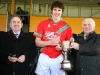 Brian Mulhall (captain, St. Martins) receives the under-21 Roinn 'A' cup from Michael Lyng (sponsor, Michael Lyng Motors) and Ned Quinn (Chairman, Kilkenny County Board) after St. Martins victory over Ballyhale Shamrocks.