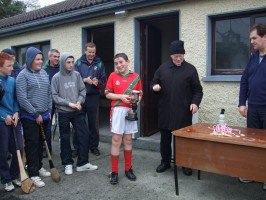 Patrick Darcy accepting the Fr. Delaney cup.
